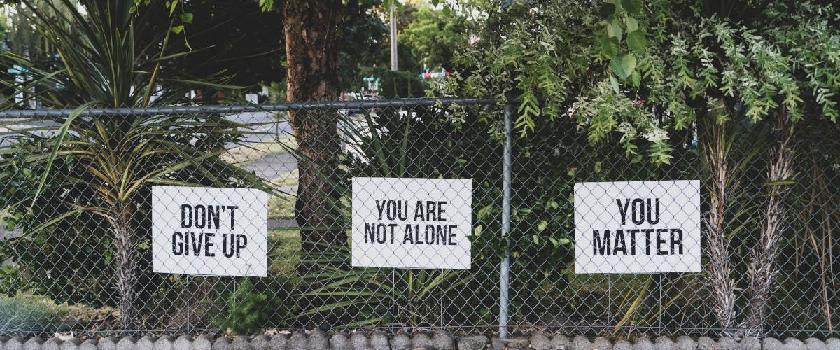 signs on a fence you are not alone culture and leadership